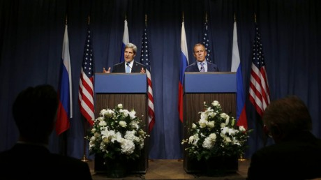 U.S. Secretary of State John Kerry speaks next to Russian Foreign Minister Sergey Lavrov, right, during a press conference before their meeting to discuss the ongoing crisis in Syria. (AP Photo/Larry Downingl)