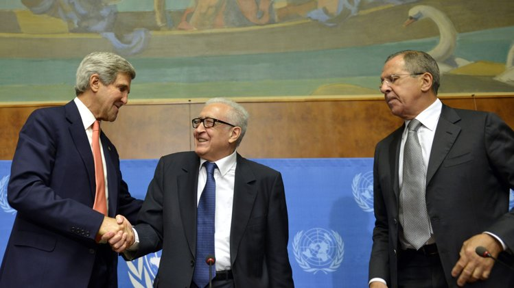 John Kerry, left, US Secretary of State, shakes hands with Lakhdar Brahimi, center, UN Joint Special Representative for Syria, next to Sergei Lavrov, right, Russian Foreign Minister during a press conference after their meeting at the European headquarters of the United Nations. (AP Photo/Keystone, Martial Trezzini)