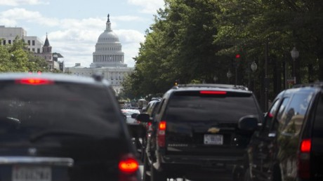 President Barack Obama's motorcade moves up Pennsylvania Ave. in the direction of the U.S. Capitol, center, Saturday, Sept. 14, 2013, in Washington, en route to Andrews Air Force Base to golf.  (AP Photo/Carolyn Kaster)