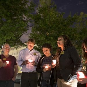 A small group holds a candle light vigil on Freedom Plaza to remember the victims of the shooting at the Washington Navy Yard, Monday, Sept. 16, 2013, in Washington. (AP Photo/J. Scott Applewhite)