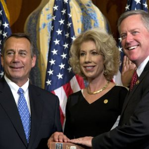 "Rep. Mark Meadows, R-N.C., right, participates in a mock swearing-in ceremony with Speaker of the House Rep. John Boehner in Washington. Emboldened conservatives who forced House Republican leaders to push a stopgap spending bill that unravels President Barack Obama's health care law are digging in for a long fight. ""Our resolve on this is unrelenting,"" said Meadows, whose letter in July to Boehner and Majority Leader Eric Cantor, R-Va., called for collaboration to ""defund one of the largest grievances in our time"" and attracted 79 Republicans. (AP Photo/ Evan Vucci)"
