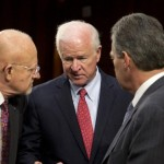 Senate Intelligence Committee Vice Chairman Sen. Saxby Chambliss, R-Ga.,center, talks with Director of National Intelligence James Clapper, left, and Deputy Attorney General James Cole on Capitol Hill in Washington. (AP Photo/Carolyn Kaster)
