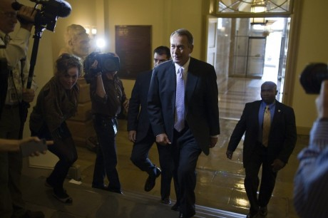 Speaker of the House John Boehner surrounded by the press (AP)