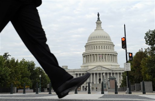 People walk near Capitol Hill in Washington, Tuesday, (AP Photo/Susan Walsh)