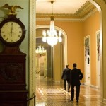 The Ohio Clock outside the Senate Chamber on Capitol Hill shows the time of 12:01 a.m. on Tuesday. (AP Photo/Evan Vucci)