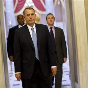 House Speaker John Boehner of Ohio walks to his office on Capitol Hill in Washington. (AP Photo/ Evan Vucci)