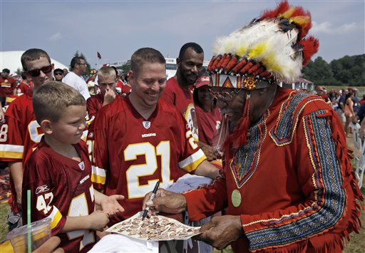 "Zena ""Chief Z"" Williams signs autographs during fan appreciation day at the Washington Redskins' NFL football training camp at Redskins Park in Ashburn, Va. (AP Photo/Alex Brandon)"