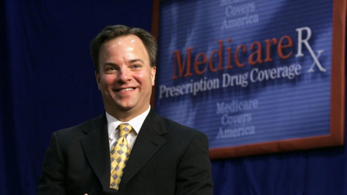 Health care law opponents smiling and saying 'told you so'