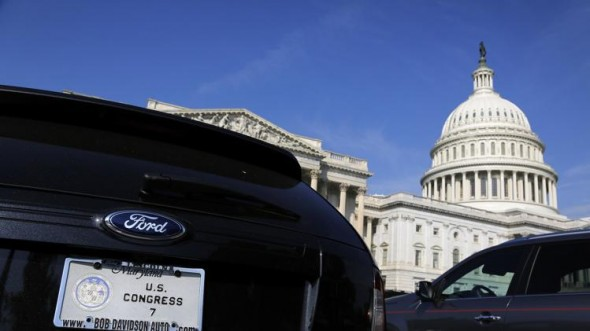 The cars of members of Congress, including one (L) belonging to a member of the Maryland delegation, fill the parking lot outside the House of Representatives during a Saturday session at the U.S. Capitol in Washington. (REUTERS/Jonathan Ernst )