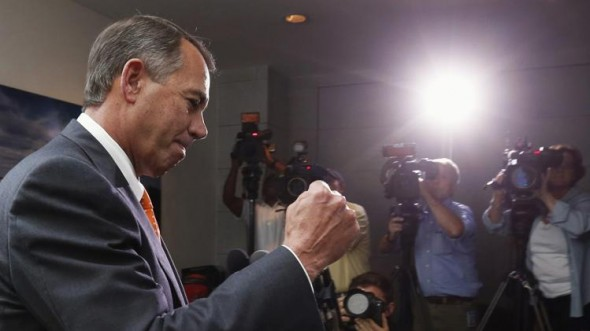 John Boehner pumps his fist...but for what? (Reuters/Kevin Lemarque)