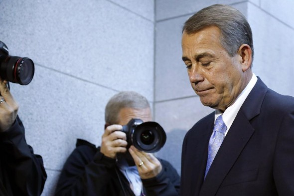 After his latest failure, John Boehner leaves GOP caucus meeting. (Reuters/Jonathan Ernst)