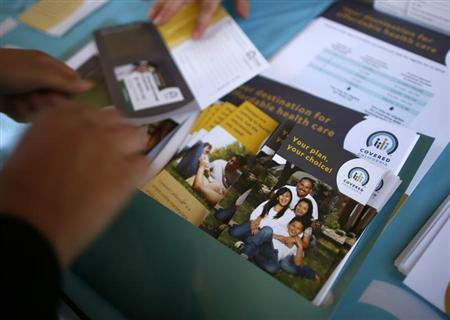 People sign up for health insurance information at a Covered California event.  (REUTERS/Lucy Nicholson)
