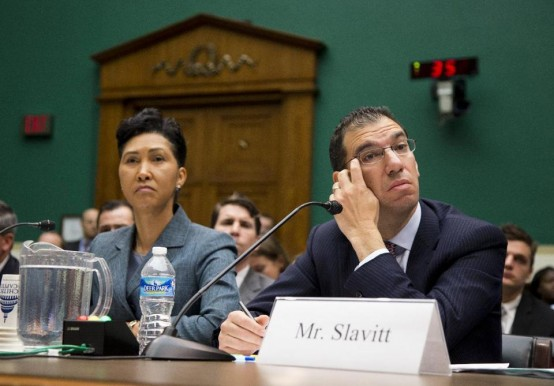 Cheryl Campbell of CGI and Andy Slavitt, QSSI, answer questions at hearing. (AP/Evan Vucci)
