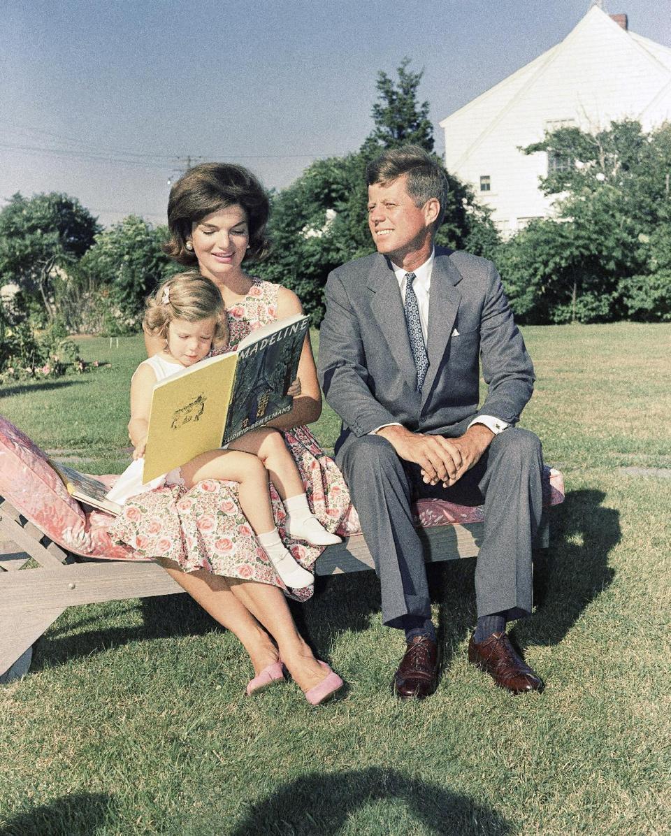 Sen. John F. Kennedy in Hyannis Port, Mass., with wife Jackqueline and daughter Caroline in July 1960. (AP)