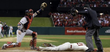 Cards take Word Series lead on obstruction call