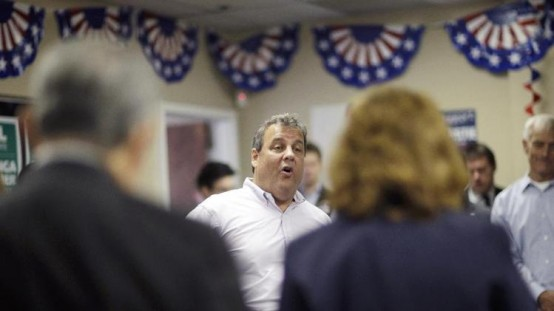 New Jersey Gov. Chris Christie talks to campaign workers in Brunswick. (AP/Mel Evans)