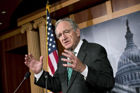 Sen. Tom Harkin (D-Iowa) talks to reporters. (AP/J. Scott Applewhite)