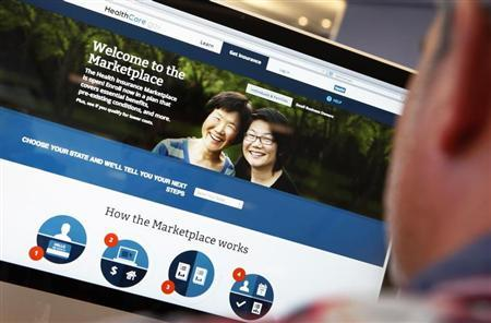 A man looks over the Affordable Care Act (commonly known as Obamacare) signup page. (REUTERS/Mike Segar)
