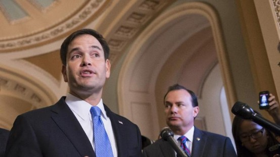 Sen. Marco Rubio, R-Fla., left, accompanied by Sen. Mike Lee, R-Utah, speaks during a news conference on Capitol Hill. (AP Photo/J. Scott Applewhite, File)