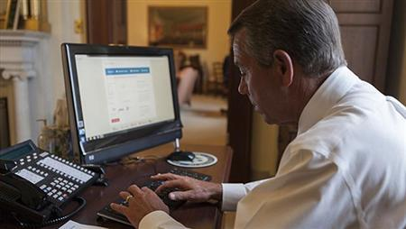House Speaker John Boehner attempts to sign up for healthcare on the DC Health Link in Washington, in this handout photo. (Speaker.gov/Handout)