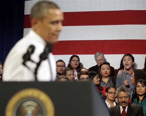 President Barack Obama stops his speech and turns around in response to an unidentified man, right, who heckled him about anti-deportation policies, at the Betty Ann Ong Chinese Recreation Center in San Francisco.  (AP Photo/Pablo Martinez Monsivais)