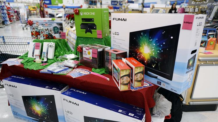 Electronic items which will be discounted for Black Friday sales are seen on display at the Wal-Mart Supercenter in the Porter Ranch section of Los Angeles November 26, 2013. This year, Black Friday starts earlier than ever, with some retailers, including Wal-Mart, opening early on Thanksgiving evening. (REUTERS/Kevork Djansezian )