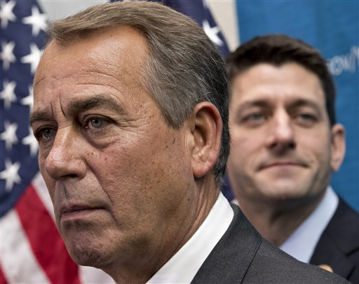 House Speaker John Boehner of Ohio, left,  joined by House Budget Committee Chairman Rep. Paul Ryan, R-Wis. (AP Photo/J. Scott Applewhite)