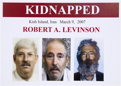 An FBI poster showing a composite image of retired FBI agent Robert Levinson, right, of how he would look like now after five years in captivity, and an image, center, taken from the video, released by his kidnappers, and a picture before he was kidnapped.  (AP Photo/Manuel Balce Ceneta)