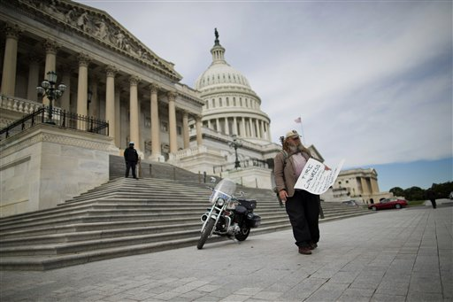 "Rick Hohensee of Washington carrying a ""Fire Congress"" sign near the House steps on Capitol Hill in Washington.  (AP Photo/ Evan Vucci)"
