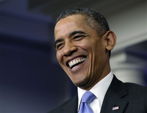 President Barack Obama laughs as he is asked a question during an end-of-the year news conference (AP Photo/Susan Walsh)