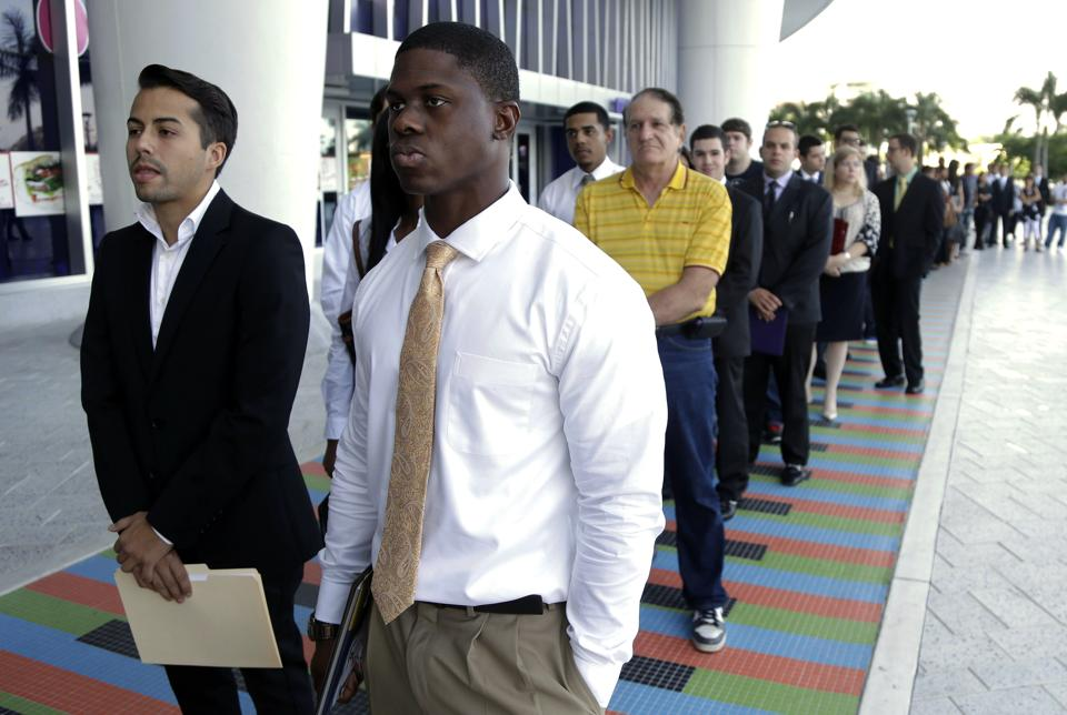 Job seekers wait in line in Miami (AP/Lynne Slacky)