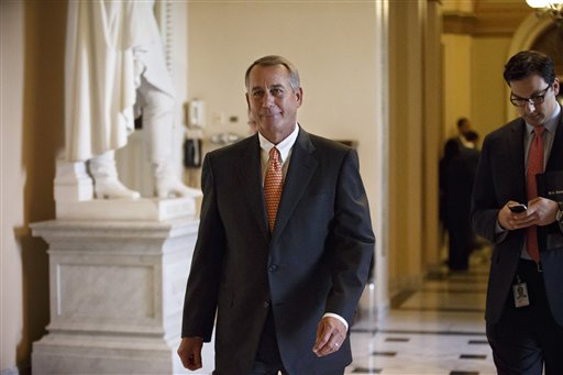 House Speaker John Boehner of Ohio leaves the House chamber on Capitol Hill in Washington, after the final vote on a massive $1.1 trillion spending bill. (AP Photo/J. Scott Applewhite)