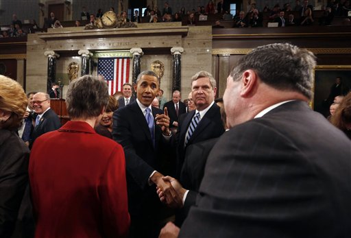 President Barack Obama shakes hands as he leaves after giving the State of Union address before a joint session of Congress in the House chamber.  (AP Photo/Larry Downing, Pool)