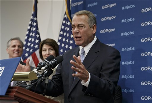 House Speaker John Boehner of Ohio, right, accompanied by House Majority Whip Kevin McCarthy of Calif., left, and Rep. Cathy McMorris Rodgers, R-Wash., speak to reporters Tuesday on Capitol Hill in Washington. (AP Photo/J. Scott Applewhite)