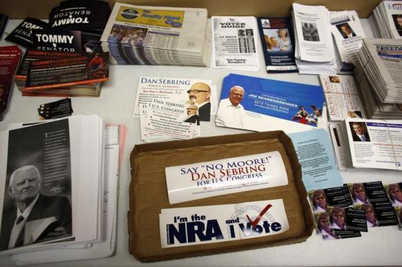The Republican party information table is seen at a Romney/Ryan office as volunteers get in their last efforts the day before election day in Wauwatosa, Wisconsin November 5, 2012. (REUTERS/Darren Hauck)