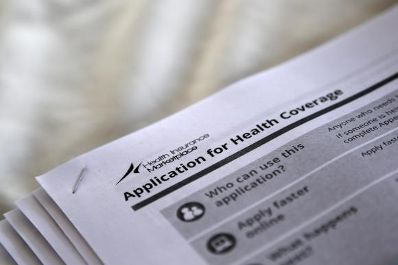 The federal government forms for applying for health coverage. (REUTERS/Jonathan Bachman)