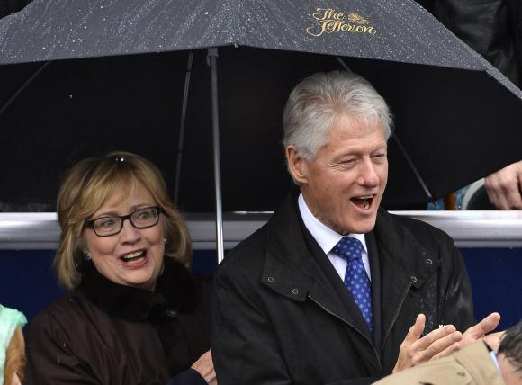 Former President Bill Clinton and his wife, former Secretary of State Hillary Clinton. (REUTERS/Mike Theiler)
