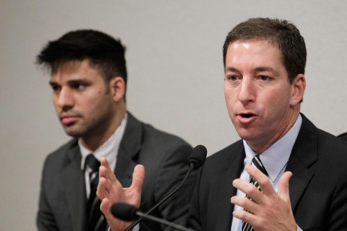 American journalist Glenn Greenwald and partner David Miranda. (AP Photo/Eraldo Peres)