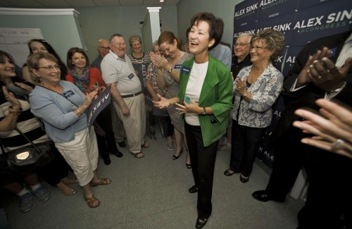 Alex Sink, center, at her Congressional campaign office.. (AP Photo/Steve Nesius)