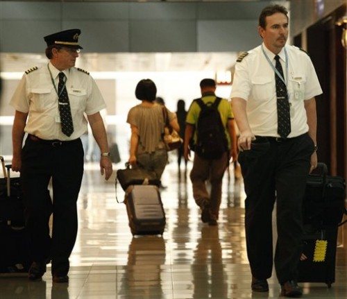 Two pilots from Cathay Pacific. (AP Photo/Vincent Yu, File)