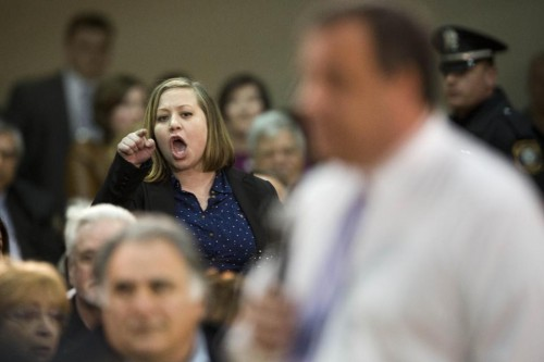 An audience member shouts at New Jersey Gov. Chris Christie  (AP Photo/Matt Rourke)