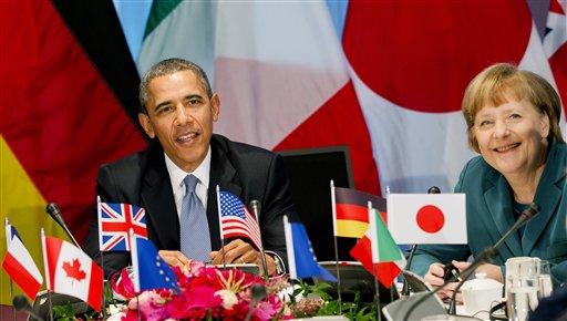 President Barack Obama and German Chancellor Angela Merkel  (AP Photo/Jerry Lampen)