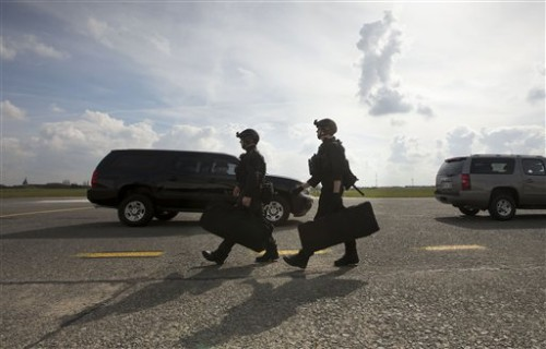 Members of the US Secret Service's Counter Assault Team, known in the agency as CAT,  (AP Photo/Pablo Martinez Monsivais)