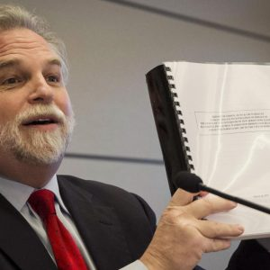 Attorney Randy Mastro holds up a copy of his report.  (AP Photo/Brendan McDermid, Pool)