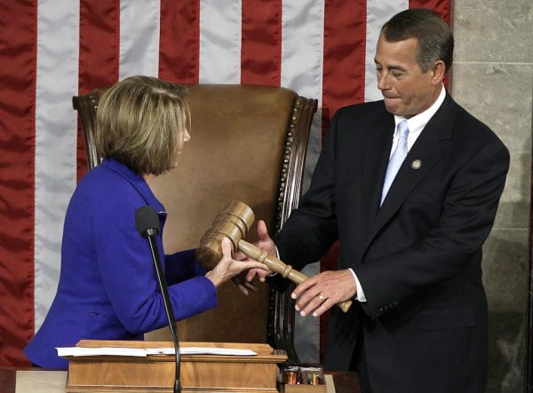 Outgoing House Democratic House Speaker Nancy Pelosi turns over the gavel to incoming Republican boss John Boehner in 2011. (AP Photo/Charles Dharapak)