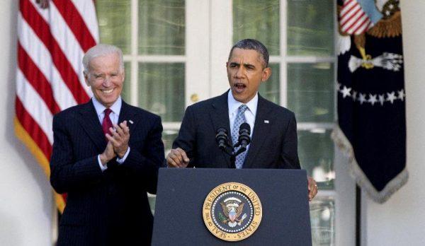 President Barack Obama, with Vice President Joe Biden, speaks in the Rose Garden of the White House in Washington, Tuesday.  (AP Photo/Carolyn Kaster)