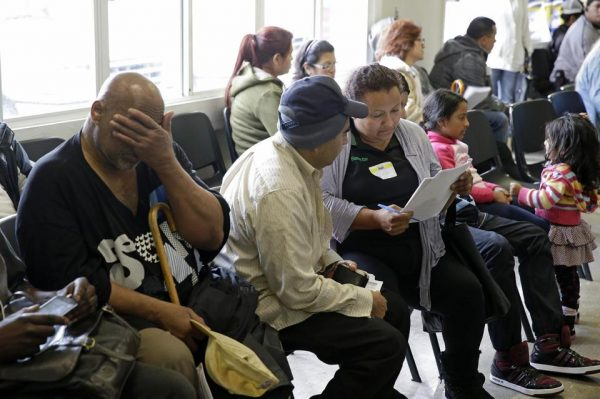 Applicants waiting to be called during a health care enrollment event at the Bay Area Rescue Mission in Richmond, Calif. (AP Photo/Eric Risberg)
