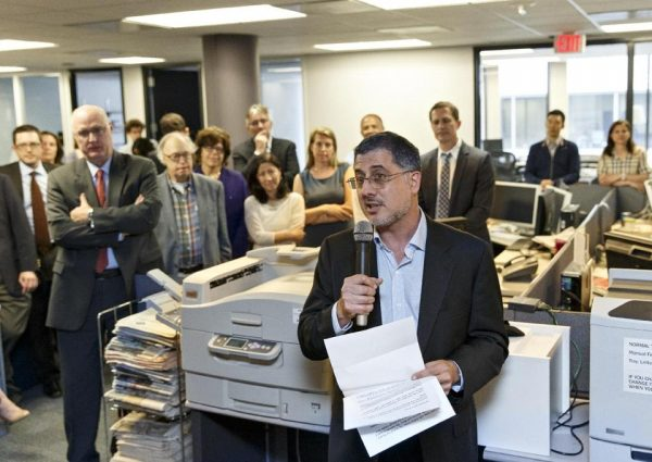 After the Pulitzer Prize for Public Service was awarded to The Washington Post, reporters and editors gather in the newsroom in Washington Monday. (AP Photo/J. Scott Applewhite)