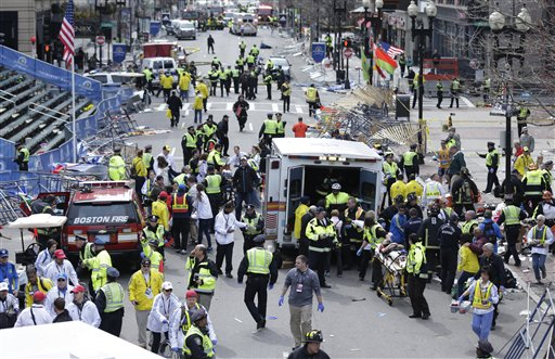 Medical workers aid injured people following an explosion at the finish line of the 2013 Boston Marathon in Boston.   (AP Photo/Charles Krupa, File)