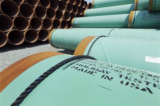 About 500 miles worth of coated steel pipe manufactured by Welspun Pipes, Inc., originally for the Keystone oil pipeline, stored in Little Rock, Ark. (AP Photo/Danny Johnston, File)